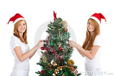 Sisters decorating christmas tree