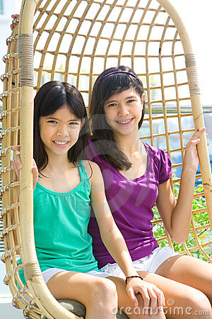 Sisters enjoying the rattan swing