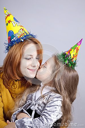 Sisters four and eighteen years old at birthday.
