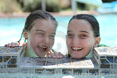 Sisters Having Fun in a Swimming Pool Outdoors
