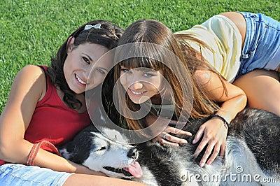 Sisters and husky