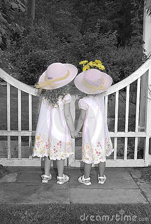 Sisters Looking over Garden Gate