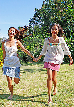 Free Sisters Running In The Park Royalty Free Stock Photos - 1739478