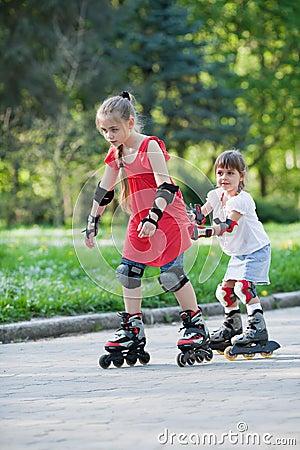 Sisters skating in park