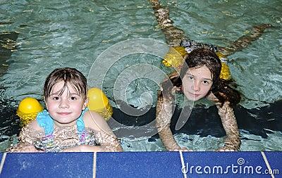 Sisters in swimming pool