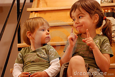 Let Me Tell You About School - Siblings With Books Talking At ...