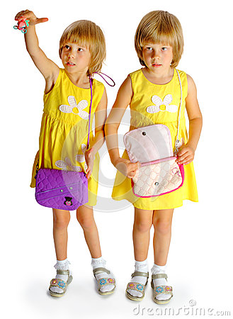 Sisters twins in yellow dresses