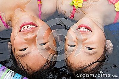 Sisters at a wading pool