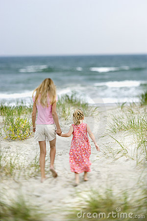Sisters walking on beach.
