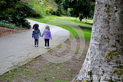 Sisters walking together in the park