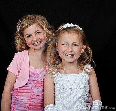 Sisters in white pink dress on black