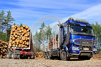 Sisu Logging Truck and Trailer Full of Wood Editorial Photo