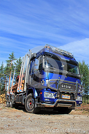Sisu Polar Logging Truck and Blue Sky Editorial Stock Photo