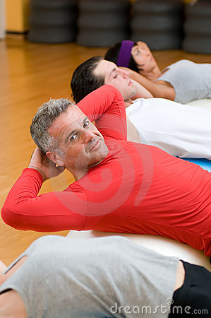 Sit-ups exercises at gym