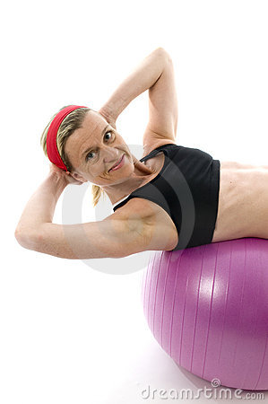 Sit ups  middle age woman fitness core ball