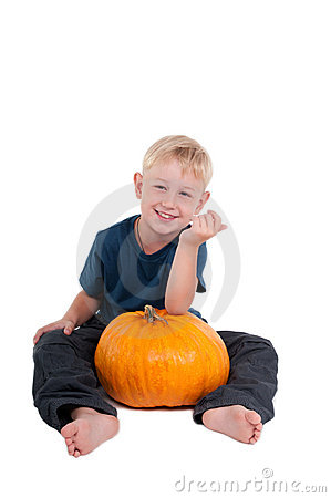Sitting boy with pumpkin