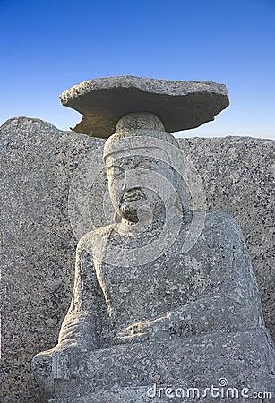 Sitting buddha with stone hat