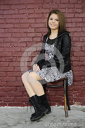 Free Sitting By A Painted Brick Wall Stock Photography - 36049762