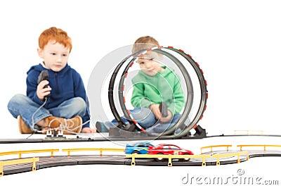 Sitting children playing kids racing toy car game