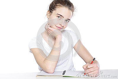 Sitting female teenager with open empty book