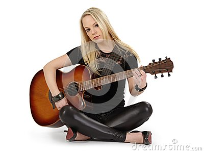 Sitting on the floor playing guitar