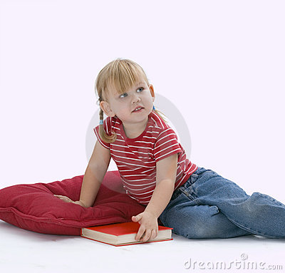 Sitting on floor, on red pillow little girl