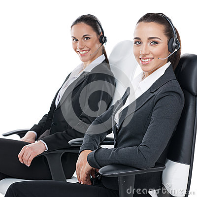 Sitting with headsets on