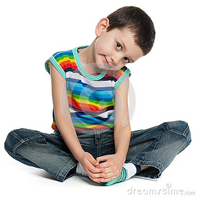 Sitting little boy in striped shirt
