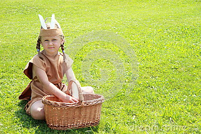 Sitting little indian girl with wicker basket