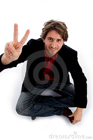 Sitting man showing peace sign
