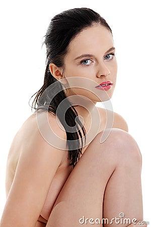 Sitting naked girl closeup.