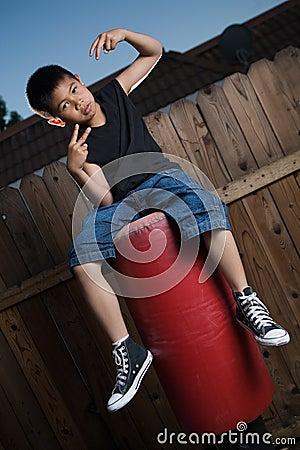 Free Sitting On A Punching Bag Royalty Free Stock Photo - 2756875
