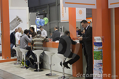 Sitting people on AquaTherm 2011 in Prague Editorial Photo