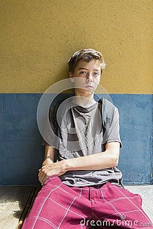 Sitting teenage boy Stock Photo