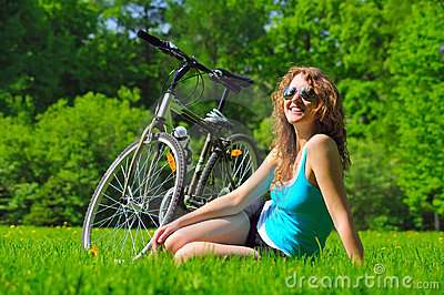 Sitting woman near her bike