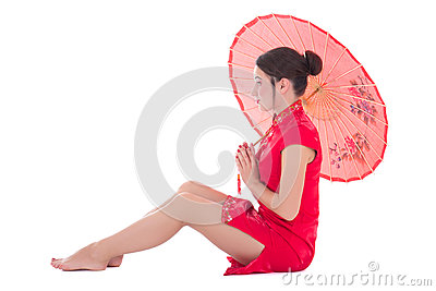 Sitting woman in red japanese dress with umbrella isolated on wh