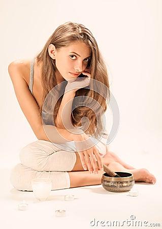 Sitting young beautiful woman SPA relaxing