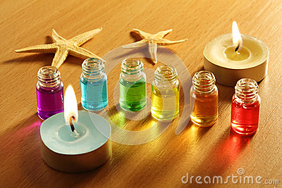 Six bottles with aroma oils, candles and starfish