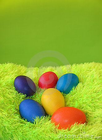 Six easter eggs on green