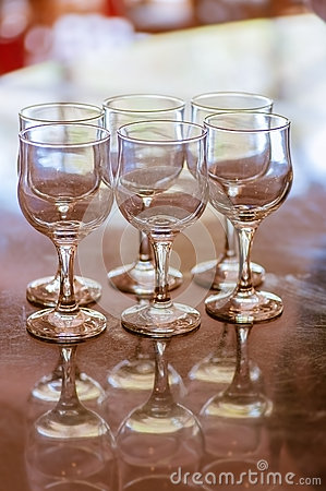 Six empty crystal wine glasses