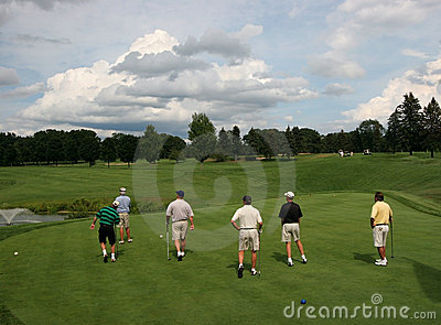 Six golfers on golf course