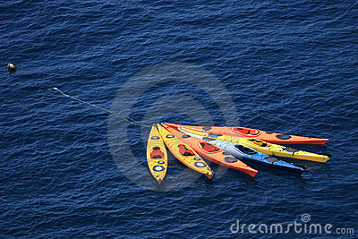 Six kayaks floating in the sea