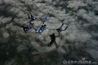 Six skydivers building a formation