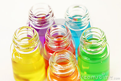 Six small opened glassy bottles of aromatic oils
