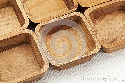 Six square wooden bowls