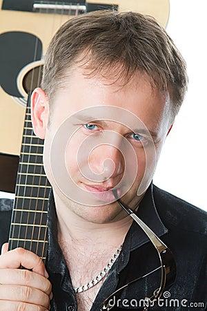Free Six-string  Guitar And  Guitarist Man Royalty Free Stock Photos - 23782038