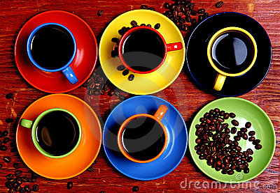 Six varicoloured cups with coffee