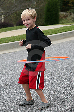 Free Six Year Old Boy Exercising With A Hula Hoop Stock Photo - 11451000