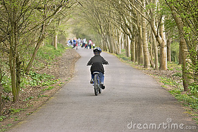 Six year old boy riding his bike