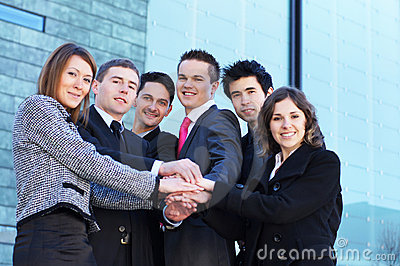Six young businessperson holding hands together
